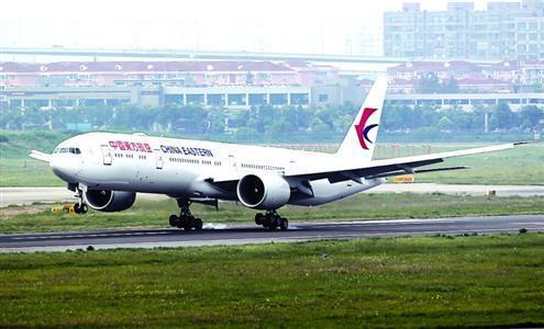 色播777_东航最先进波音777-300er抵沪 座位自带刷卡槽